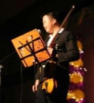 Dressed formally in a suit, Ho Wai Keen could be easily mistaken for a professional violin player as he came on stage to perform 'Wind-up', a song which he played gracefully.