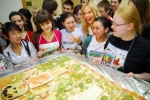 Best Buddies Russia celebrated Best Buddies Month by baking a cake together and having a party with Russian pop star, Glukoza.