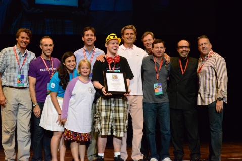 "Daniel Noltemeyer receiving the ""Spirit of Friendship"" Award, presented by the Best Buddies Board of Directors."