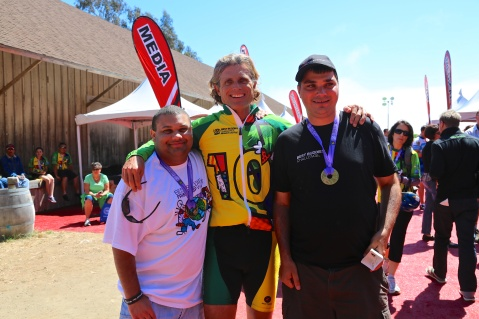 Best Buddies Ambassador Brian Hayes, Best Buddies Founder & Chairman Anthony K. Shriver, and Best Buddies Ambassador John Hammond celebrate at the 0th Anniversary Best Buddies Challenge: Hearst Castle finish line.