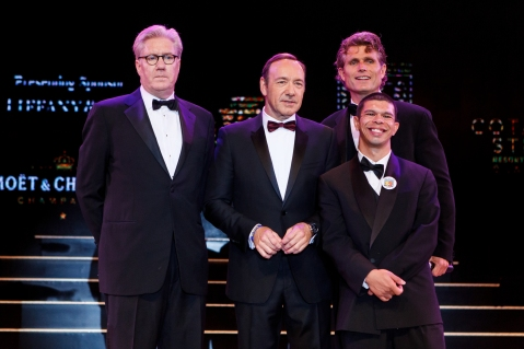 (Left to right) Edward Tracy, President and Chief Executive Officer of Sands China Ltd.; long-time Best Buddies supporter, Kevin Spacey; (right back) Anthony Kennedy Shriver, founder of Best Buddies International; and (right front) Charles Calhoun, Buddy Ambassador, took a group photo on-stage at The Venetian Macao Saturday night at Sands China's annual charity ball. This year's Venetian Ball 2014: A Night of Glitz and Glamour, with Tiffany & Co. as Presenting Sponsor raised funds for Best Buddies Macao – a chapter of Best Buddies International.